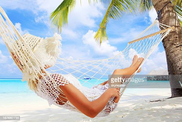 Woman relaxing in a hammock.