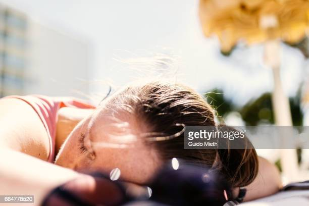 Woman relaxing in a hotel park.