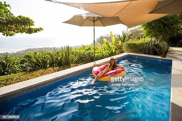 A woman relaxing in a private pool.