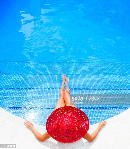 woman relaxing in a resort swimming pool