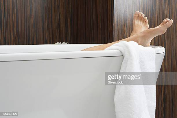 woman relaxing in bathtub, low section - white women feet stock pictures, royalty-free photos & images
