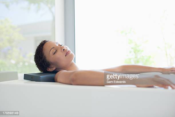 woman relaxing in bathtub - taking a bath stock pictures, royalty-free photos & images