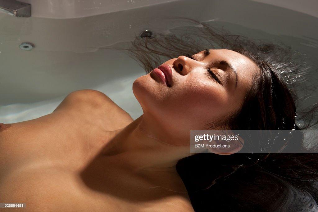 Woman relaxing in bathtub : Stock Photo