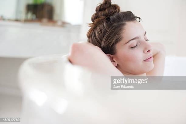 woman relaxing in bubble bath - bubble bath stock pictures, royalty-free photos & images