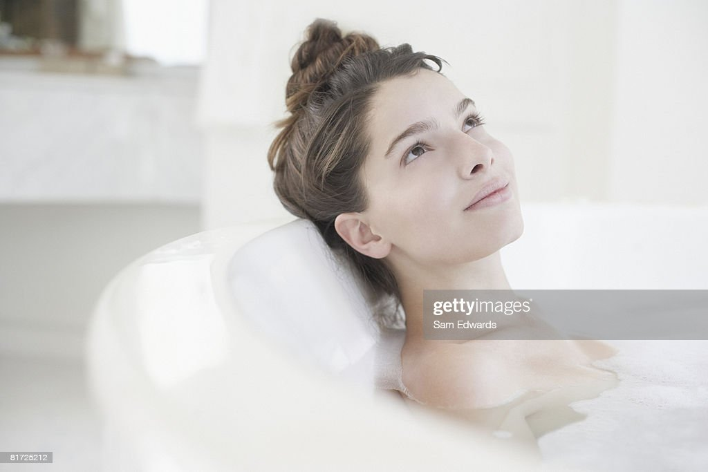 Woman relaxing in bubble bath : Stock Photo