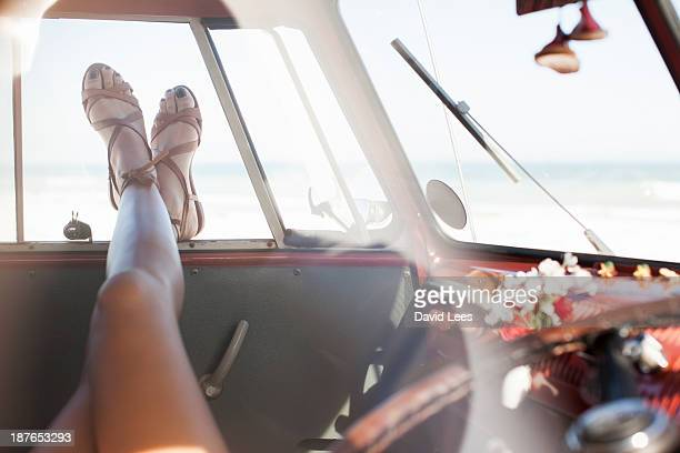 woman relaxing in camper van, legs only - sandal stock pictures, royalty-free photos & images