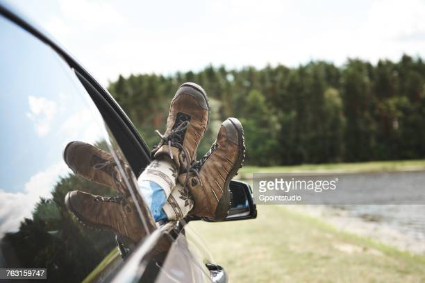 woman relaxing in car, feet through open window, focus on feet - mujeres fotos stock pictures, royalty-free photos & images
