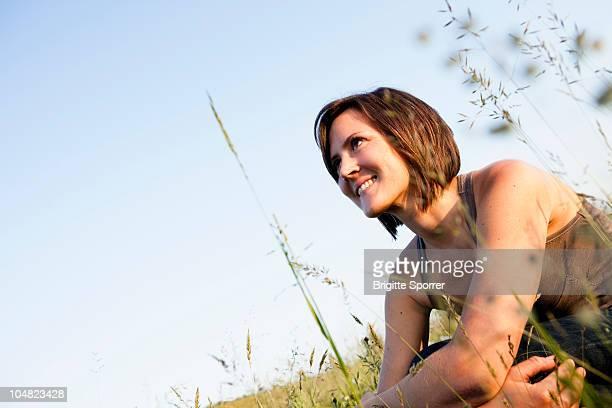 Woman relaxing in field