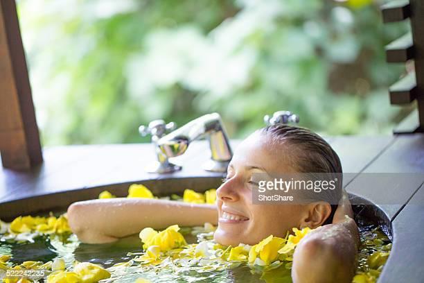 Woman relaxing in flower bath