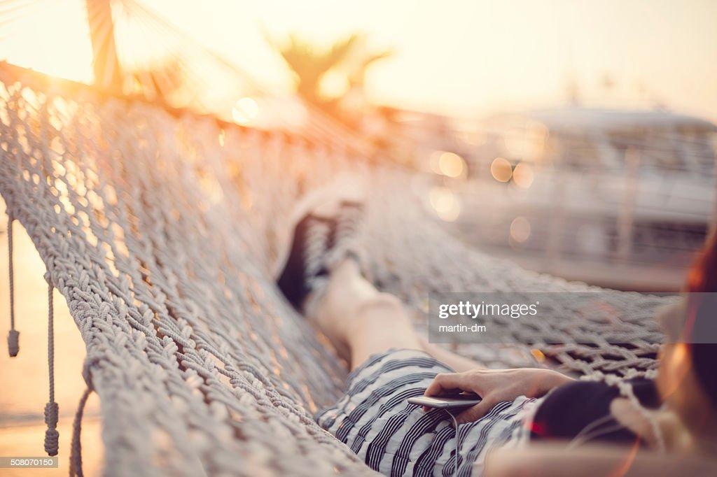 Woman relaxing in hammock : Stock Photo