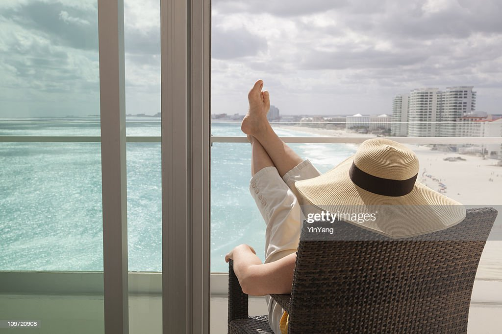 Woman Relaxing in Hotel Balcony of Beach Resort : Stock Photo