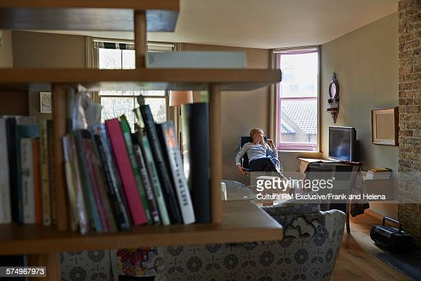 Woman relaxing in living room