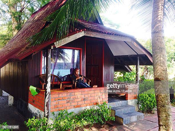 woman relaxing in log cabin - hilal stock photos and pictures