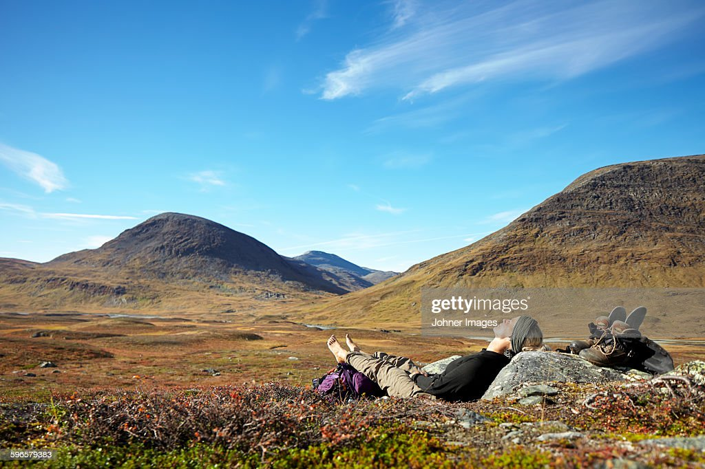 Woman relaxing in mountains : Stock Photo