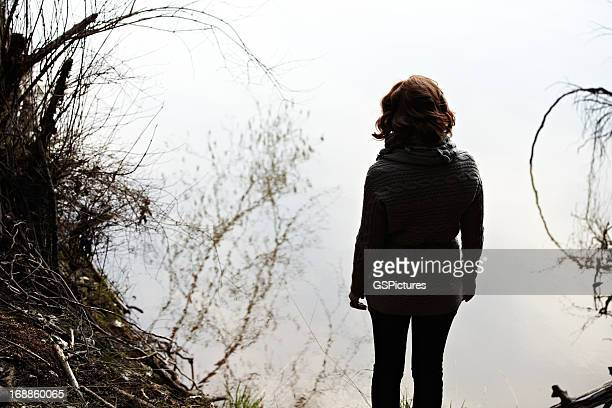 Woman relaxing in nature near lake