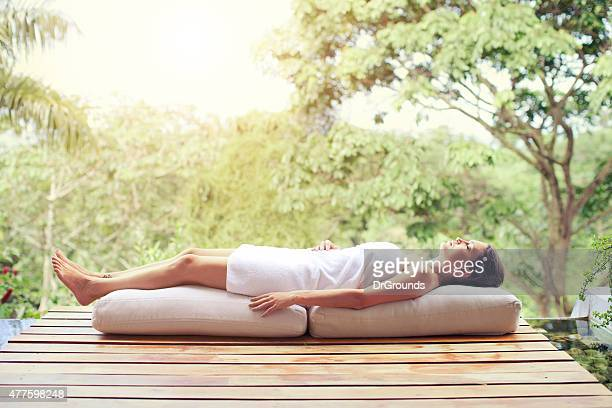 Woman relaxing in nature spa