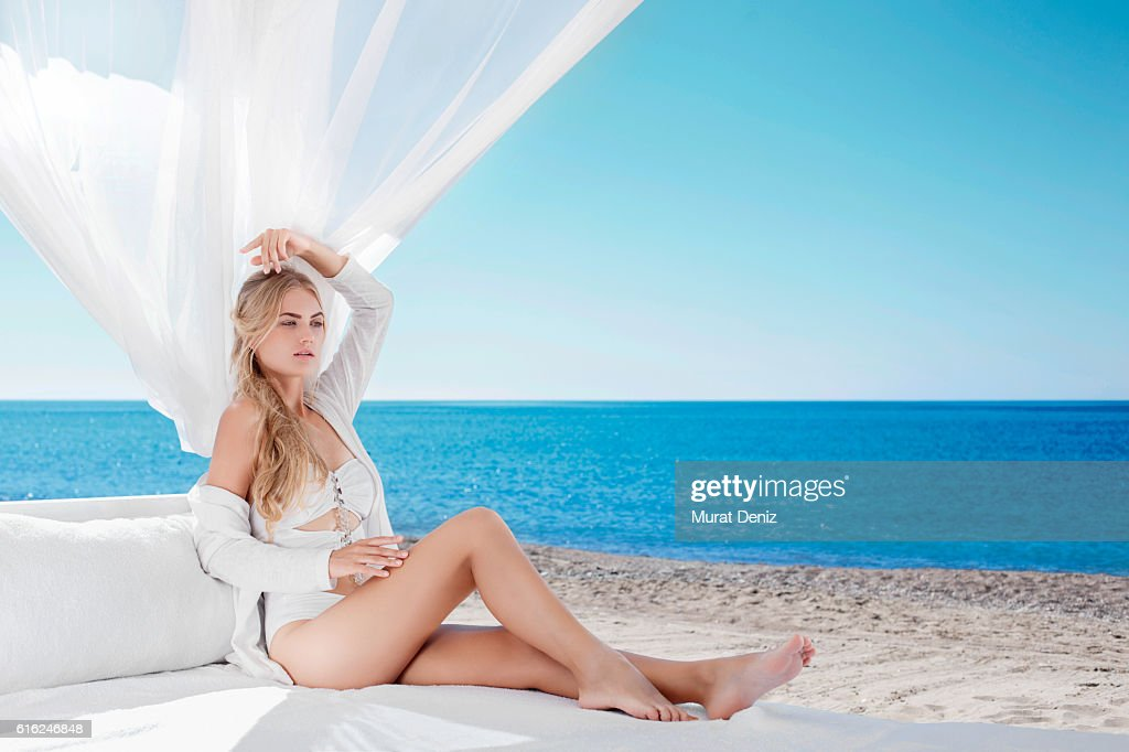Woman relaxing in pavillion : Stock Photo