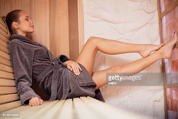 Woman relaxing in salt room and enjoying in halotherapy treatmen