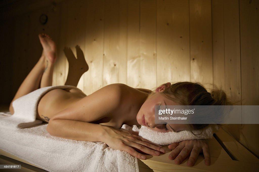 Woman relaxing in sauna : Stock Photo