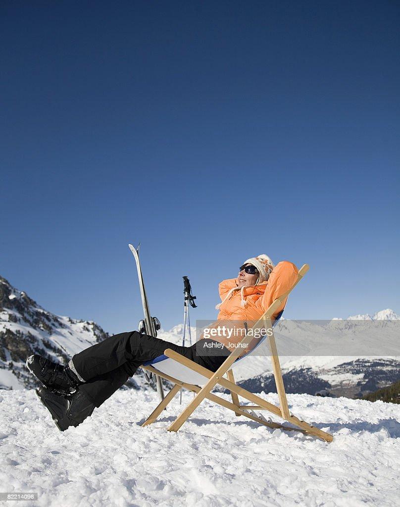 Woman (40-45) relaxing in snowy landscape : Stock Photo