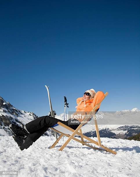 Woman (40-45) relaxing in snowy landscape
