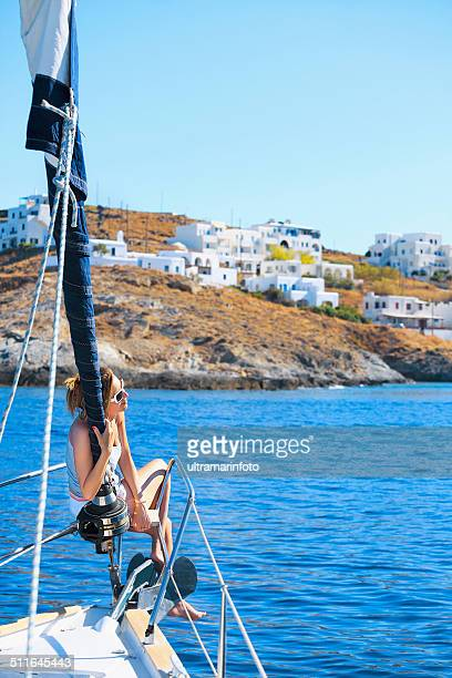 Woman relaxing in sunshine on the  sailing ship