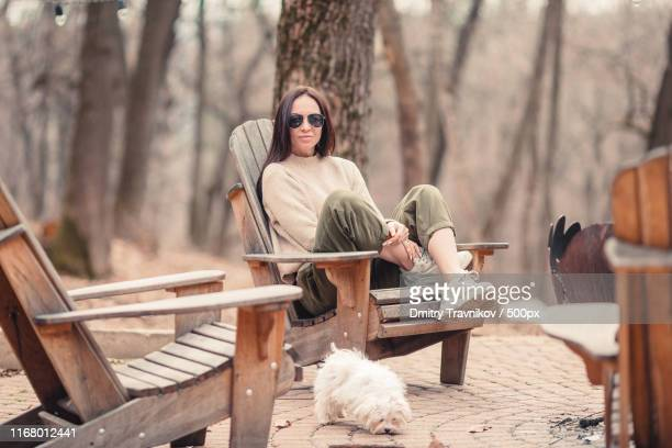 woman relaxing in the forest on weekeend - girl blows dog stock photos and pictures