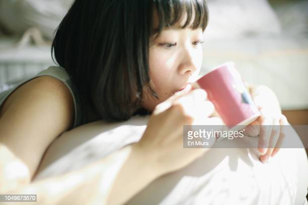 a woman relaxing in the room - morning ストックフォトと画像