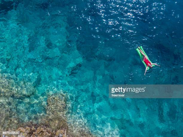 woman relaxing in the sea - greece stock pictures, royalty-free photos & images