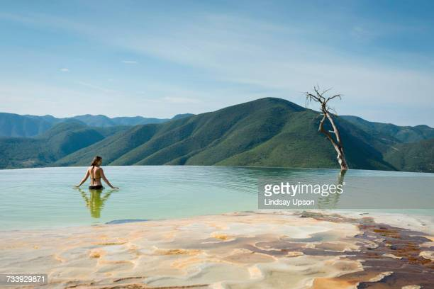 woman relaxing in thermal spring, hierve el agua, oaxaca, mexico. - hot spring stock pictures, royalty-free photos & images