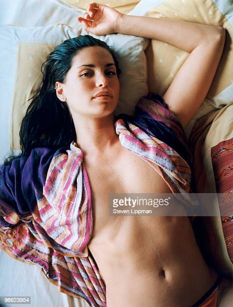 Woman relaxing in unbuttoned shirt