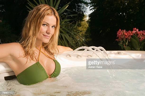Woman relaxing in whirl pool