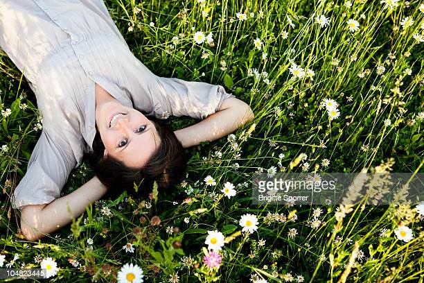 Woman relaxing in wild meadow