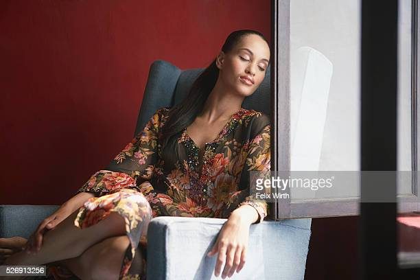 Woman relaxing near window
