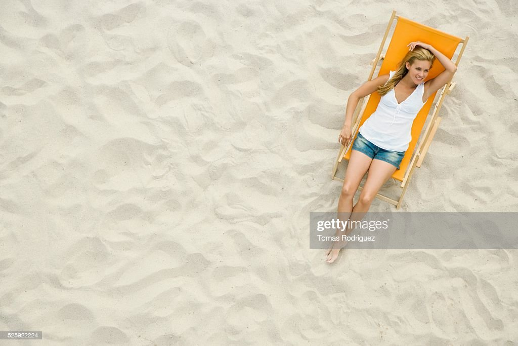 Woman Relaxing on a Beach : Stock Photo