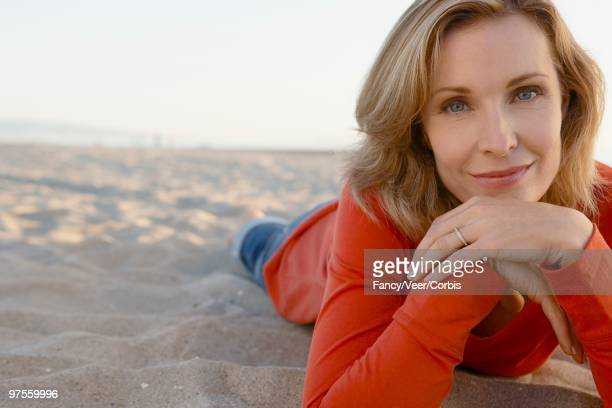 woman relaxing on a beach - hand on chin stock pictures, royalty-free photos & images