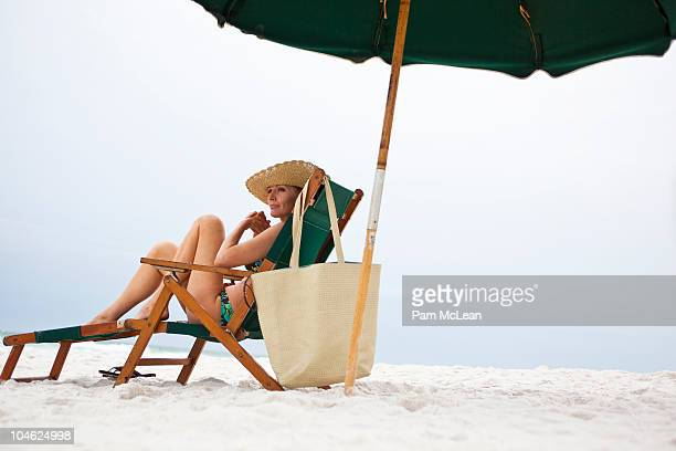 Woman relaxing on a sunlounger on the beach
