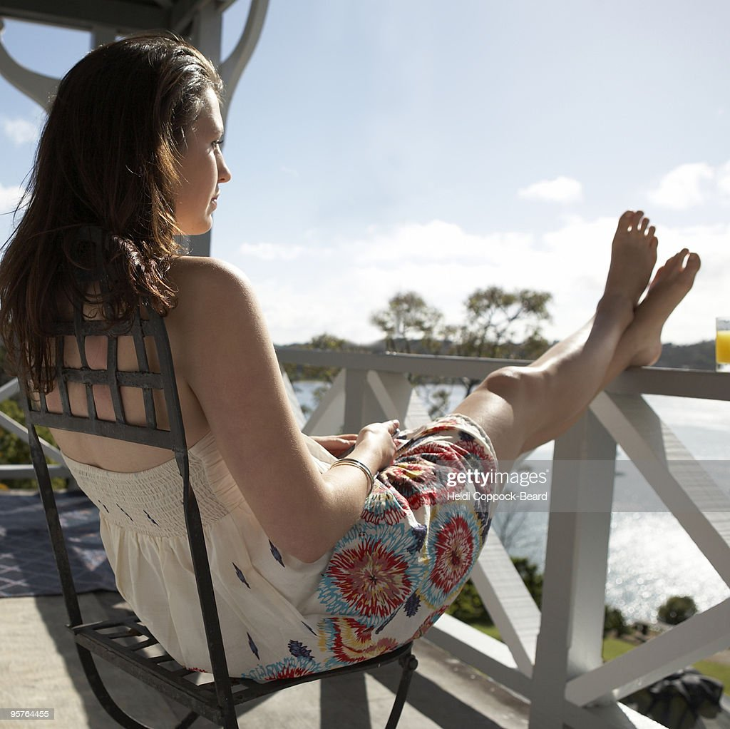 woman relaxing on balcony  : Stock Photo
