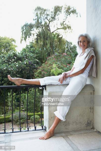 woman relaxing on balcony - old lady feet stock pictures, royalty-free photos & images