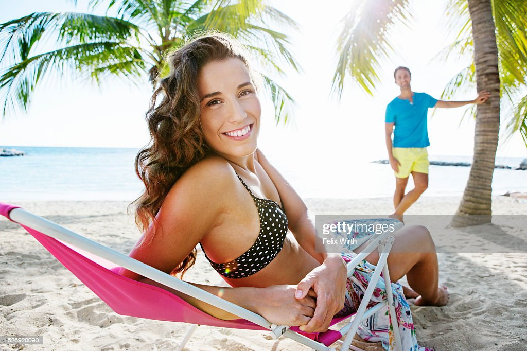 Woman relaxing on beach lounger : Photo