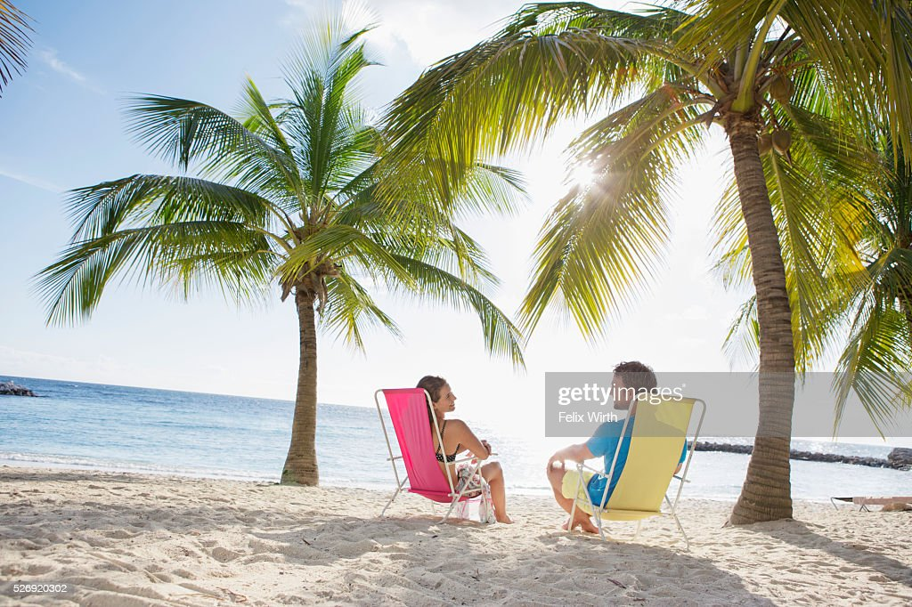 Woman relaxing on beach lounger : Stock-Foto