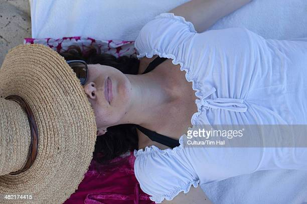 woman relaxing on blanket - one mature woman only stock pictures, royalty-free photos & images