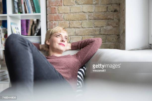 Woman relaxing on couch at home