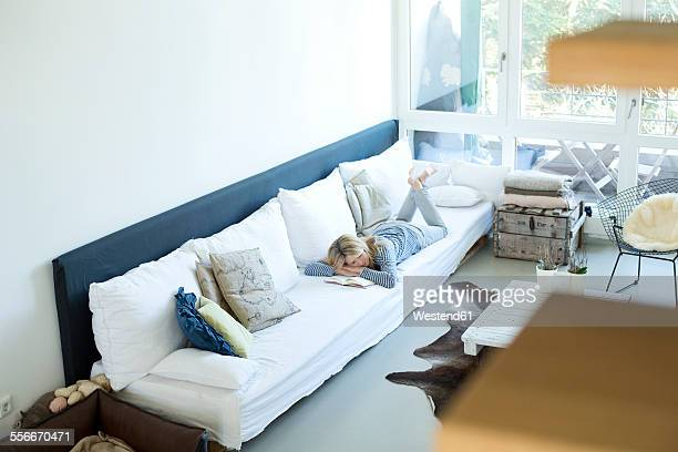 Woman relaxing on couch in her living room