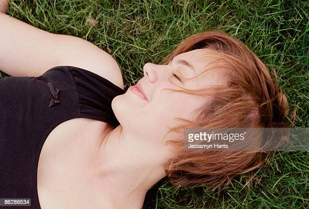woman relaxing on grass - jessamyn harris stock pictures, royalty-free photos & images