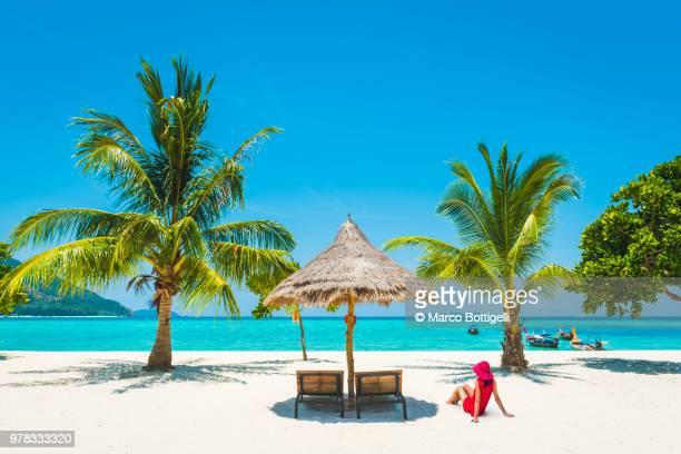 Woman relaxing on idyllic tropical beach