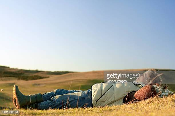 Woman relaxing on meadow