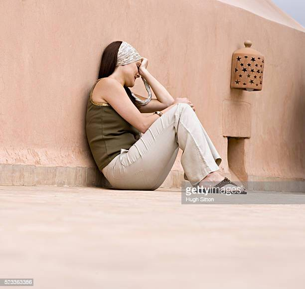 woman relaxing on morrocan patio - hugh sitton stock pictures, royalty-free photos & images