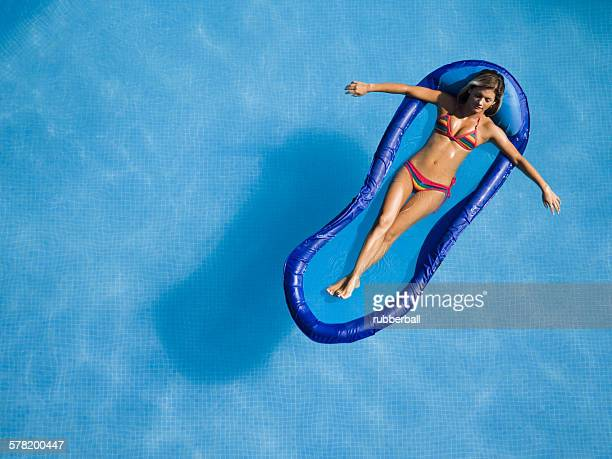 Woman relaxing on pool lounger