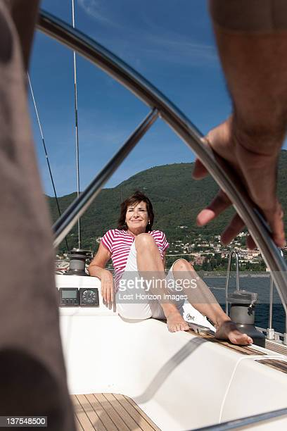 Woman relaxing on sailboat with husband